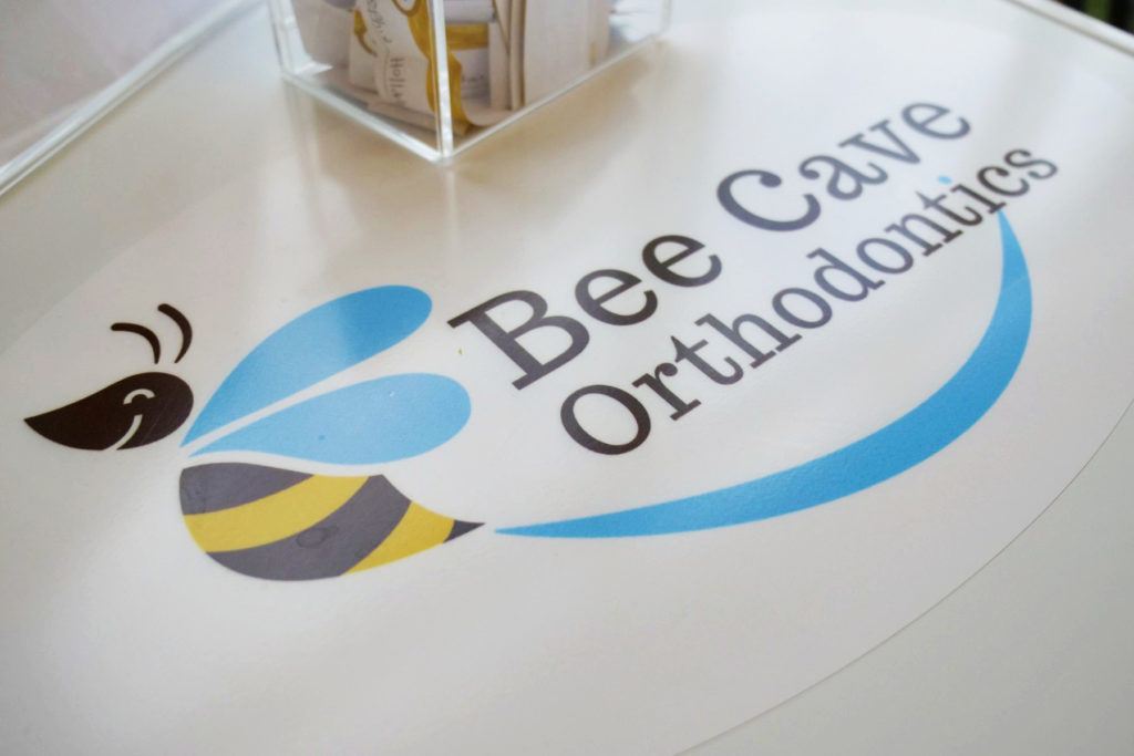 Bee Cave Orthodontics logo on table