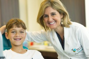 Dr. Adriana with a young patient at Bee Cave Ortho